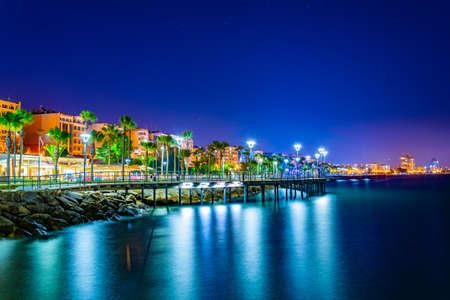Night view of Molos promenade with several piers leading to the mediterranean sea in Limassol, Cyprus Archivio Fotografico - 115522557