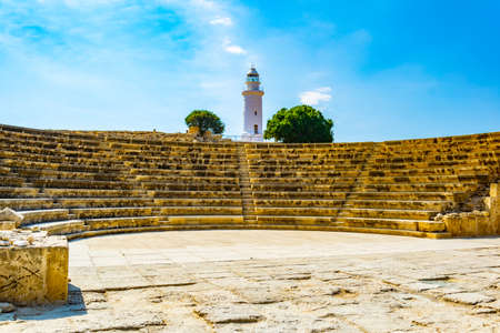 Roman theatre situated under a white lighthouse at Paphos Archaeological Park on Cyprus