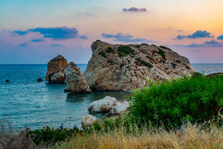 Sunset view over Petra tou Romiou alas Aphordite's rock on Cyprus Archivio Fotografico - 115526000