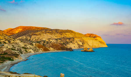 a small peninsula offering viewpoint over Petra tou Romiou alas Aphordite's rock on Cyprus Banco de Imagens