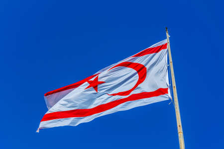 Flag of republic of northern cyprus on blue sky Stock Photo