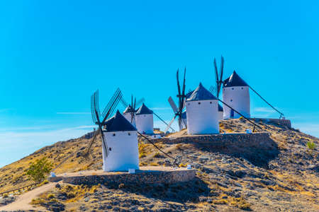 Traditional white windmills at Consuegra in Spain Imagens