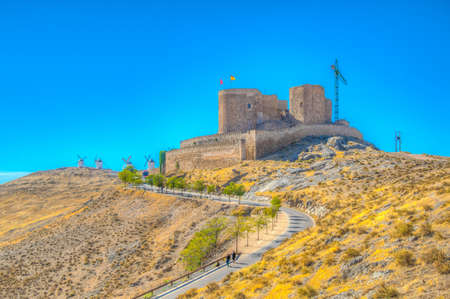 Castle at Consuegra surrounded with white windmills, Spain