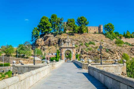 Alcantara bridge over river Tajo with San servando castle at background at Toledo, Spain