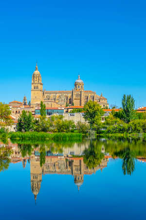 Cathedral at Salamanca reflected on river Tormes, Spain