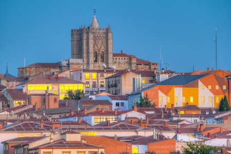 Sunset view of cityscape of Avila dominated by Cathedral of Saint Salvador, Spain Stock Photo