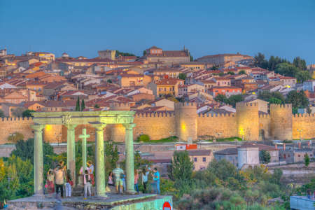 Sunset view of Avila from los cuatro postes viewpoint, Spain