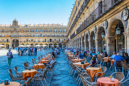 SALAMANCA, SPAIN, OCTOBER 5, 2017: People are strolling through Plaza Mayor at Salamanca, Spain