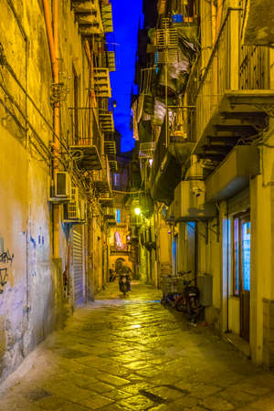 Night view of a narrow street in Palermo, Sicily, Italy