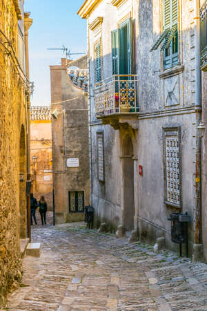View of a narrow street in the historical center of Erice village on Sicily, Italy