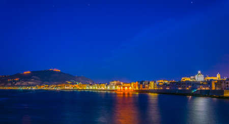 View of seaside of the sicilian city Trapani and Erice village on the hilltop during sunset, Italy Stok Fotoğraf
