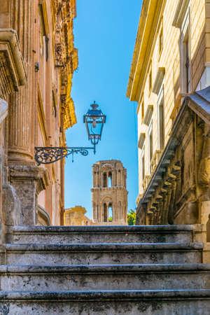 View of chiesa santa maria dell ammiraglio through a narrow street in Palermo, Sicily, Italy