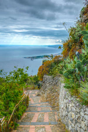 View of a promenade on the edge of Taormina town in Sicily