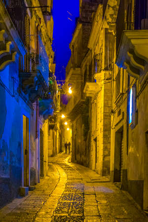 Night view of a narrow street in Ragusa, Sicily, Italy Stok Fotoğraf