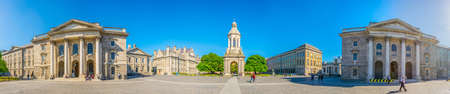 DUBLIN, IRELAND, MAY 9, 2017: Students are passing the Campanile inside of the trinity college campus in Dublin, ireland