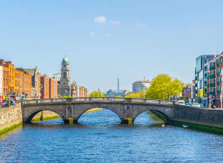 Riverside of Liffey dominated by Saint Paul's church in Dublin, Ireland Stock Photo