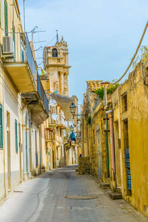 View of a narrow street in Modica, Sicily, Italy
