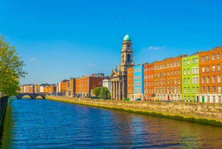 Riverside of Liffey dominated by Saint Pauls church in Dublin, Ireland