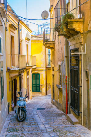 View of a narrow street in Noto, Sicily, Italy