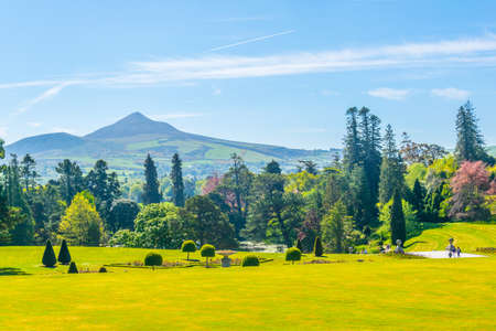 View over Powerscourt gardens towards Sugarloaf mountain in Ireland