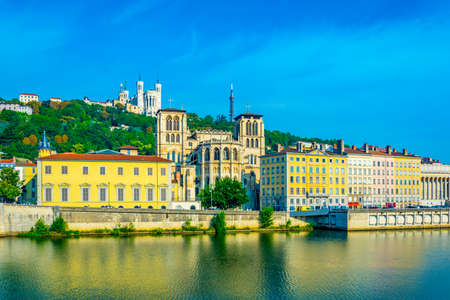 Basilique Notre Dame de Fourvi?re and cathedral saint jean Baptiste viewed behind river Saone in Lyon, France Stok Fotoğraf