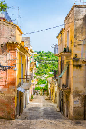 View of a narrow street in Ragusa, Sicily, Italy