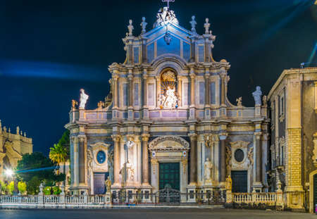 Night view of the cathedral of saint agatha and an elephant fountain in Catania, Sicily, Italy