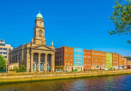 Riverside of Liffey dominated by Saint Pauls church in Dublin, Ireland