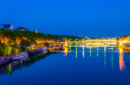 Night view of illuminated riverside of Rhone river in Lyon, France