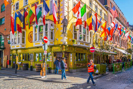 DUBLIN, IRELAND, MAY 9, 2017: People are strolling through a busy street in the Temple bar district of Dublin, Ireland