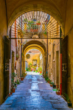 View of a narrow street in Syracuse, Sicily, Italy