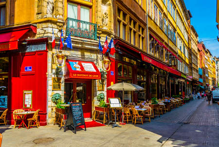 LYON, FRANCE, JULY 22, 2017: a narrow street full of restaurants is waiting for first customers to come, Lyon, France