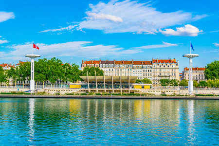 Giant flagpoles over a public swimming pool on riverside of Rhone river in Lyon, France 免版税图像
