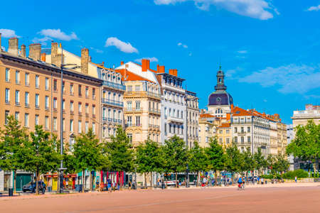 LYON, FRANCE, JULY 23, 2017: People are passing by statue of Louis XIV on Place Bellecour in Lyon, France