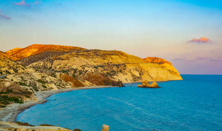 a small peninsula offering viewpoint over Petra tou Romiou alas Aphordite's rock on Cyprus 版權商用圖片