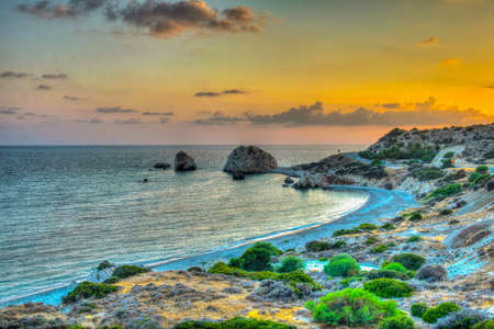 Sunset view over Petra tou Romiou alas Aphordite's rock on Cyprus