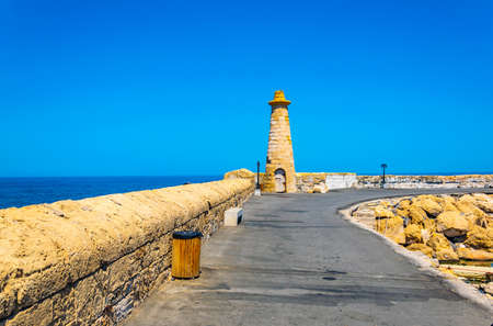 Pier at port in KyreniaGirne during a sunny summer day, Cyprus