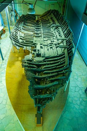 KYRENIA, CYPRUS, AUGUST 25, 2017: Petrified boat inside of the Kyrenia Castle on Cyprus
