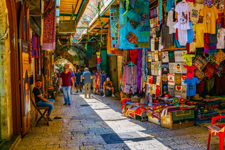 JERUSALEM, ISRAEL, SEPTEMBER 6, 2018: People are strolling among various shops situated in a narrow street in the old town of Jerusalem, Israel