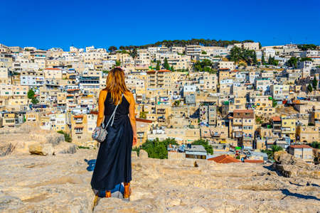 A single woman is looking at east Jerusalem, Israel Stock Photo