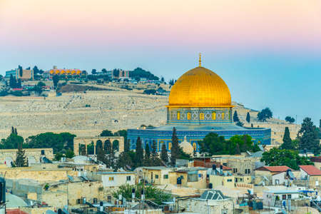 Sunset view of Jerusalem dominated by golden cupola of the dome of the rock, Israel Stock Photo