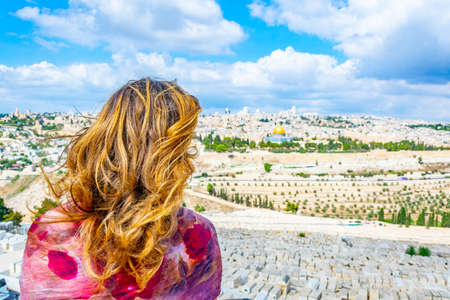 Woman is looking at Jerusalem from the mount of olives, Israel