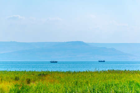 A wooden boat floating on the sea of galilee, Israel