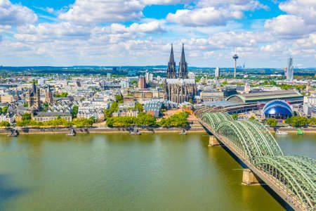 Aerial view of cityscape of Cologne with Hohenzollern bridge, cathedral and Saint Martin church, Germany Standard-Bild