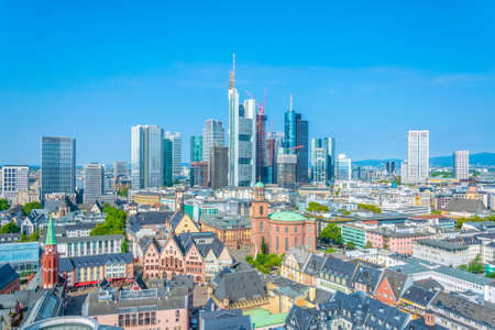 Skyscrapers of financial center of Frankfurt viewed behind Paulskirche church, Germany Banco de Imagens