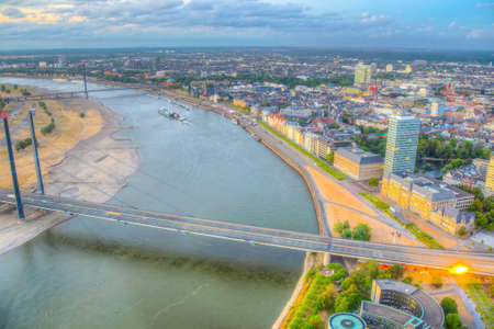 Sunset aerial view of Dusseldorf with Rheinkniebrucke bridge in Germany. Imagens