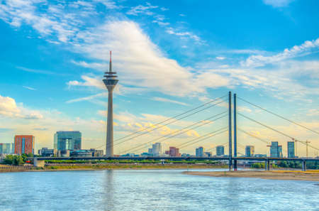 Riverside of Rhein in Dusseldorf dominated by the Rheinturm tower, Germany
