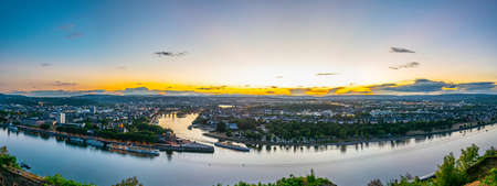Night aerial view of confluence of Rhein and Mosel rivers in Koblenz, Germany Imagens