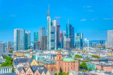 Skyscrapers of financial center of Frankfurt viewed behind Paulskirche church, Germany Фото со стока