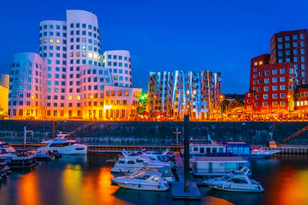 sunset view of Illuminated hafen district in Dusseldorf, Germany